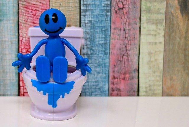 clipart omino sul wc